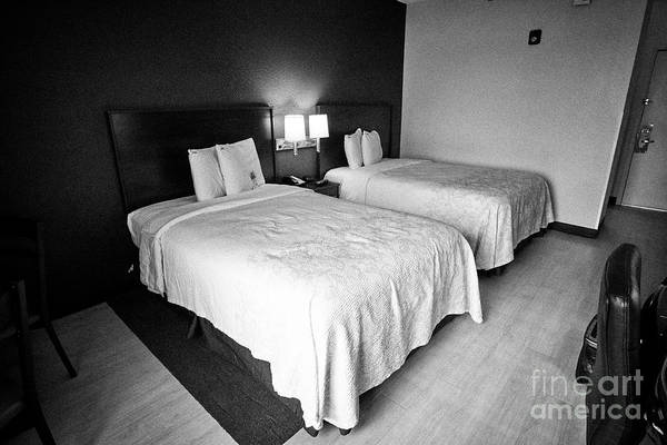 Wall Art - Photograph - Twin Queen Sized Beds In A Cheap Hotel Room Red Roof Plus Usa by Joe Fox