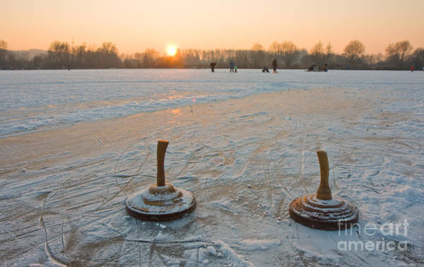 Wall Art - Photograph - Two Bavarian Curling Stones On A Frozen by Bernd Juergens