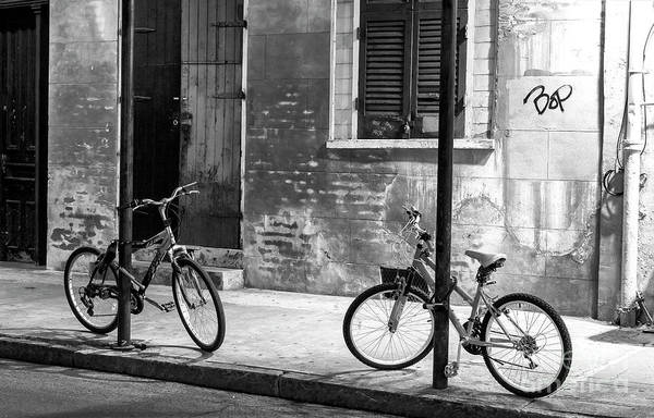 Photograph - Two Bicycles At Night In New Orleans by John Rizzuto