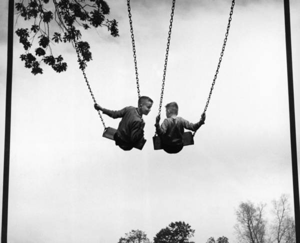 Shoulder Photograph - Two Boys 6-8 On Swings, Rear View B&w by Hulton Archive