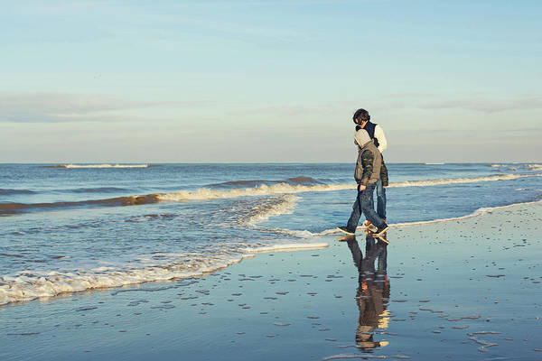 Adolescence Photograph - Two Boys Standing At The Ocean On A by Cindy Prins
