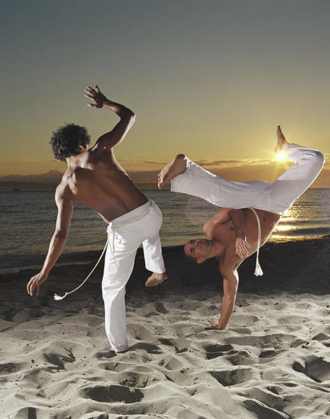 Waters Edge Wall Art - Photograph - Two Capoeira Performers On Beach At by Ryan Mcvay