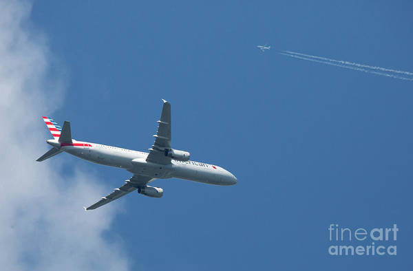 Photograph - Two Commercial Airliners In Flight by Kevin McCarthy
