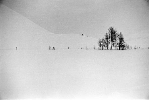 Climbing Photograph - Two Distant Figures Climbing Hill In A by Alfred Eisenstaedt