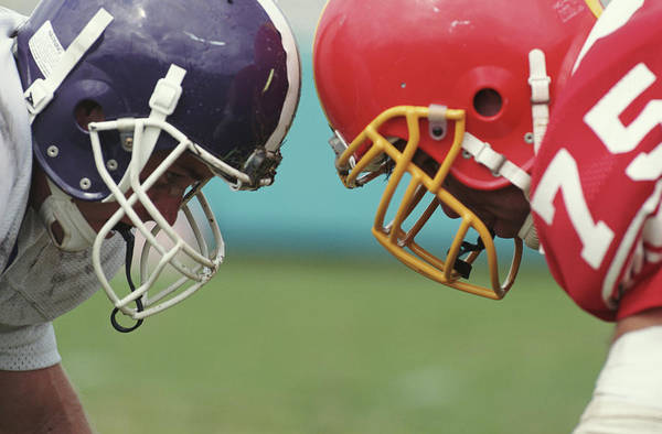Football Helmet Photograph - Two Football Players At Scrimmage, Side by Yellow Dog Productions