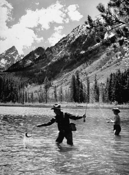 Sport Fishing Photograph - Two Friends Fishing For Trout In The Lak by Hansel Mieth