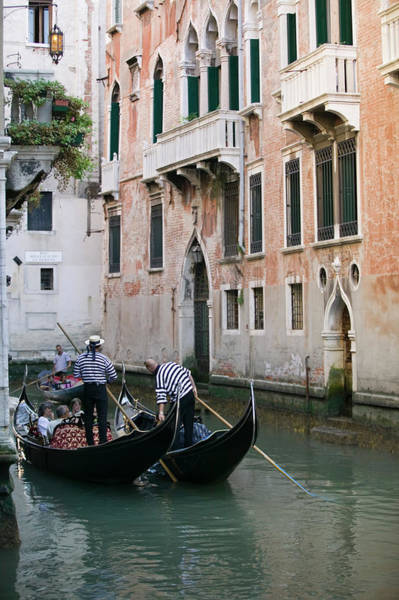 Side-by-side Photograph - Two Gondolas Side By Side In Canal In by Photodisc
