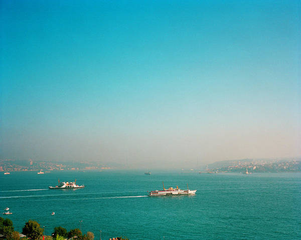 Bosphorus Bridge Photograph - Two Large Boats Crossing The Bosporus by Andrew Rowat