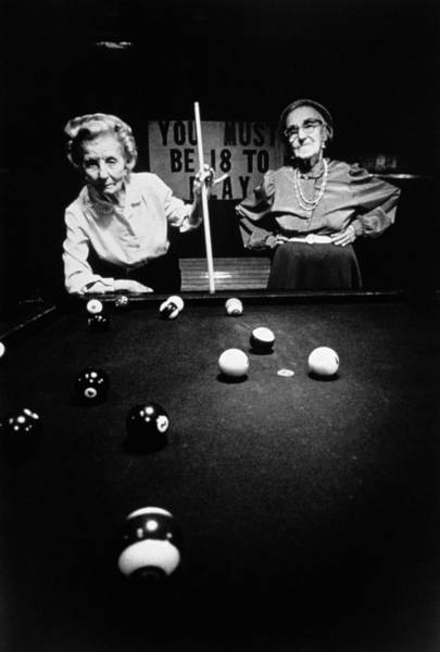 Gray Hair Photograph - Two Mature Women Playing Pool In Black by Tim Bieber