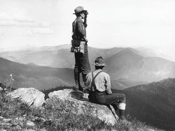 Binoculars Photograph - Two Men At Mountain Summit, One Using by Hulton Archive