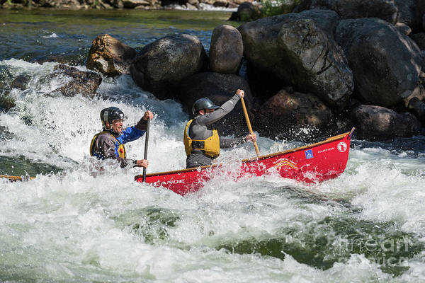 Photograph - Two Men Driving A Red Canoe Through The Rapids by Les Palenik