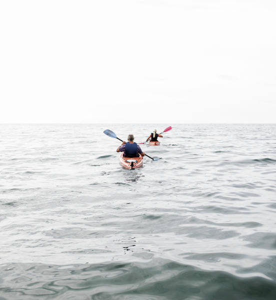 Wall Art - Photograph - Two People Kayaking In Sea by Joao Canziani