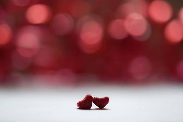 Romance Photograph - Two Red Hearts And Red Bokeh Background by G.g.bruno