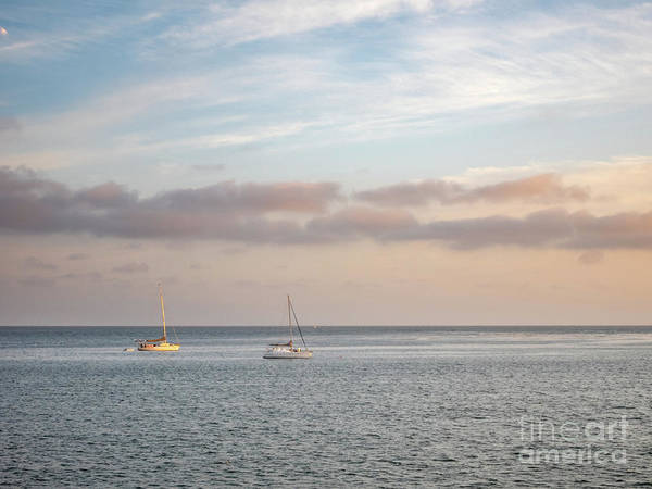 Photograph - Two Sail Boats In Ocean Sea Facing The Sunset During The Golden  by PorqueNo Studios