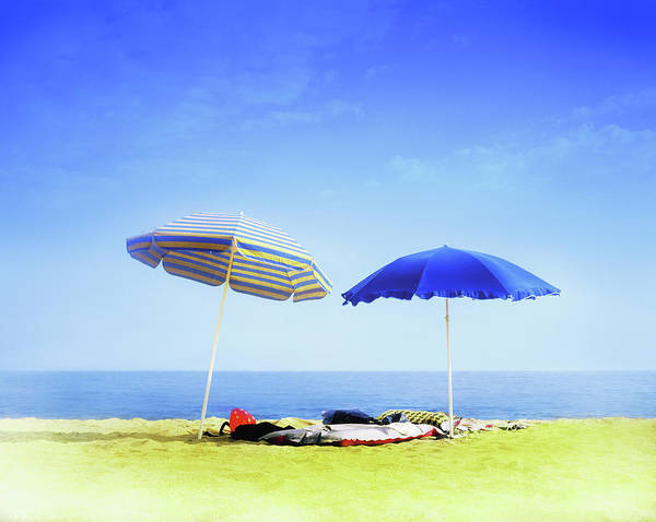 Sunshade Photograph - Two Sunshades Over Clothes, Towels And by Gandee Vasan