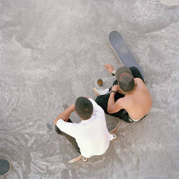 Bottle Cap Photograph - Two Teenagers Sat In Skate Park, Aerial by Uta Neumann
