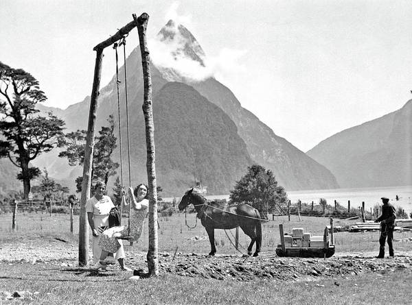 Painting - Two Unidentified Women On A Swing, And A Man Unloading Stores, Milford Sound, 1930s by Milford Sound
