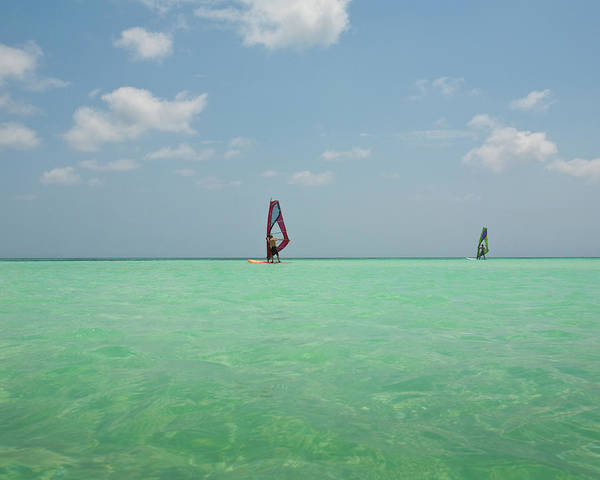 Windsurfing Photograph - Two Windsurfers In Caribbean Waters by Ashok Sinha