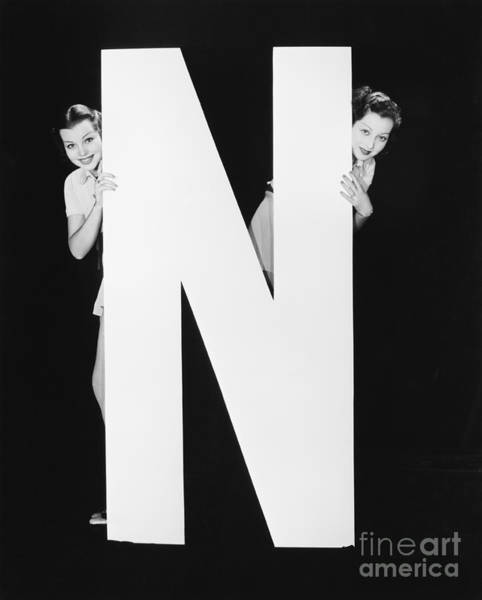 Two Friends Wall Art - Photograph - Two Women Hiding Behind Huge Letter N by Everett Collection