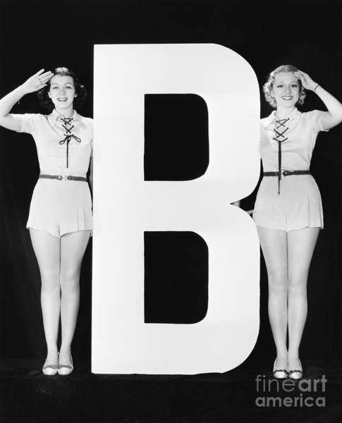 Wall Art - Photograph - Two Women Saluting With Huge Letter B by Everett Collection