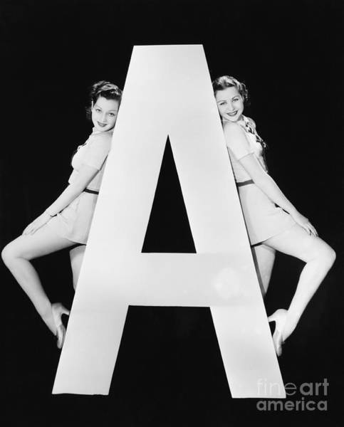 Two Friends Wall Art - Photograph - Two Women With Huge Letter A by Everett Collection