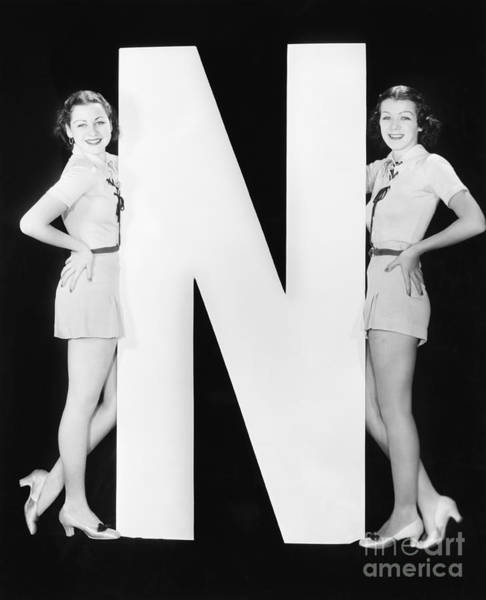 Wall Art - Photograph - Two Women With Huge Letter N by Everett Collection
