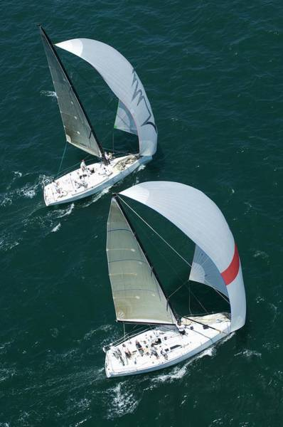 Spinnaker Photograph - Two Yachts Compete In Team Sailing by Moodboard