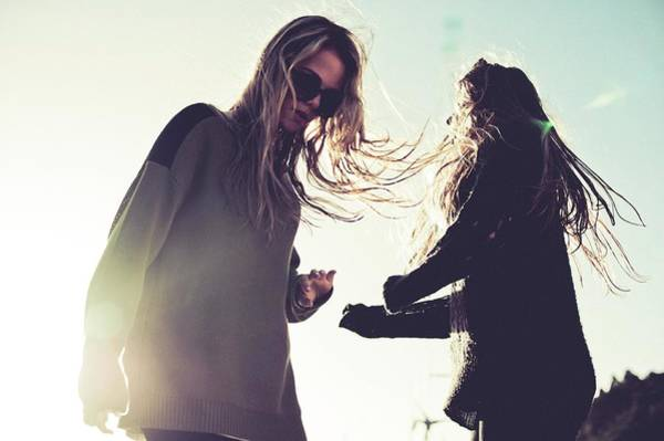 Sweater Photograph - Two Young Indie Girls Dancing In The Sun by Mareea Vegas