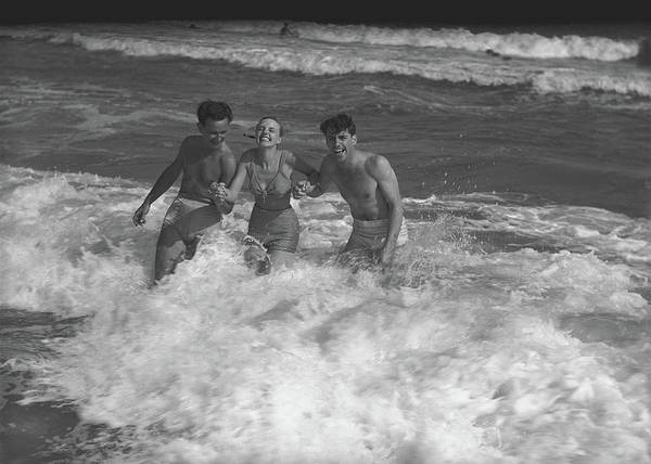 Bikini Photograph - Two Young Man And Woman Playing In by George Marks