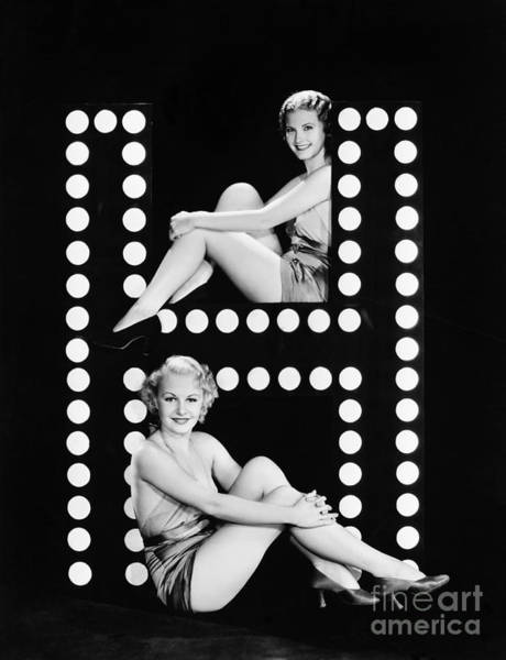 Knees Wall Art - Photograph - Two Young Women Posing With The Letter H by Everett Collection