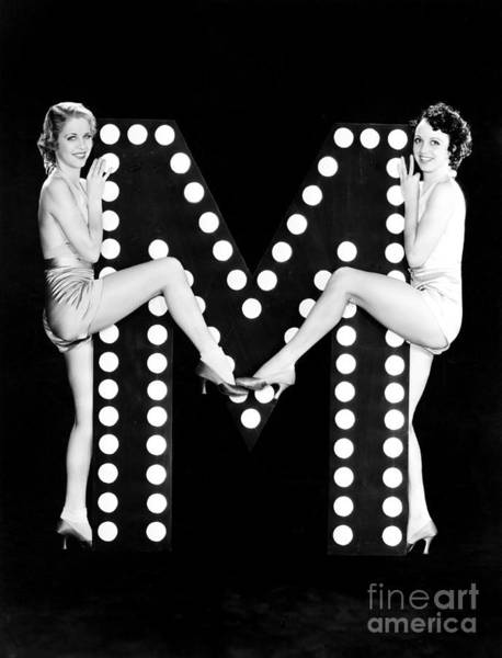 Wall Art - Photograph - Two Young Women Posing With The Letter M by Everett Collection