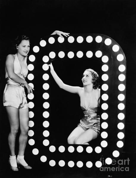 Wall Art - Photograph - Two Young Women Posing With The Letter O by Everett Collection