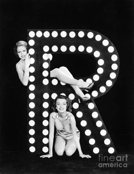 Wall Art - Photograph - Two Young Women Posing With The Letter R by Everett Collection