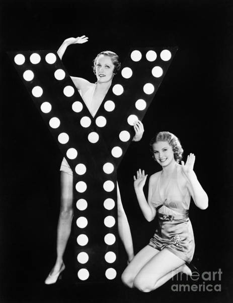 Wall Art - Photograph - Two Young Women Posing With The Letter Y by Everett Collection