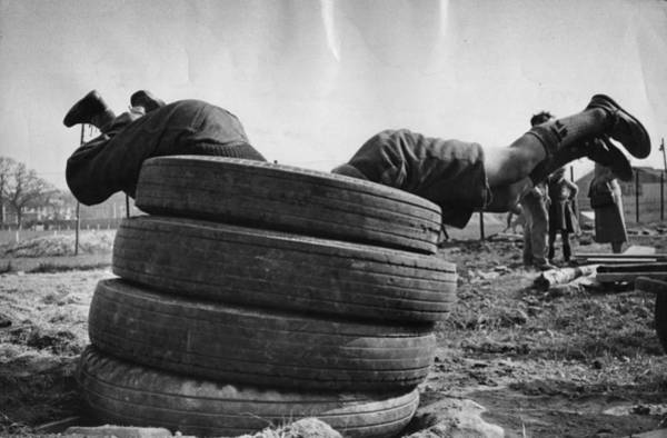 Upside Down Photograph - Tyre Dive by Thurston Hopkins