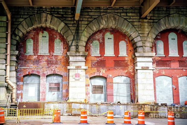 Photograph - Under The Brooklyn Bridge In New York City by John Rizzuto