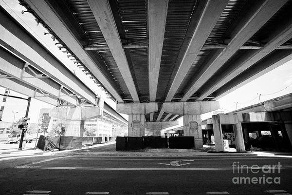 Wall Art - Photograph - underneath new i4 bridge construction in downtown Orlando Florida USA by Joe Fox
