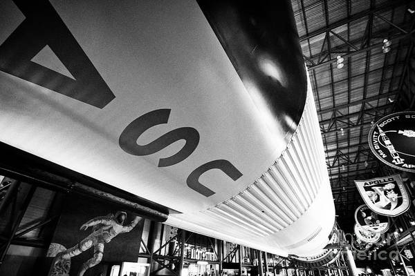 Wall Art - Photograph - underneath the Saturn V rocket in the Apollo/Saturn 5 center Kennedy Space Center Florida USA on the by Joe Fox