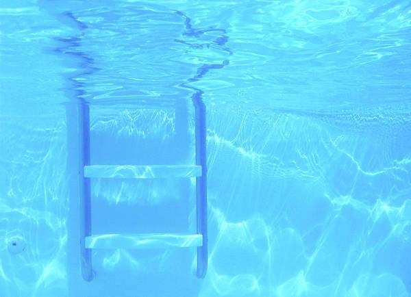 Wall Art - Photograph - Underwater Pool Ladder by Kathy Van Torne