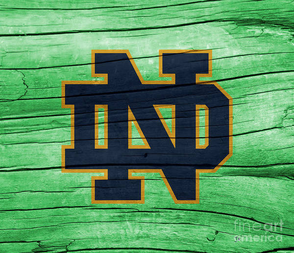 Wall Art - Photograph - University Of Notre Dame Fighting Irish Logo On Green Rustic Wood by John Stephens