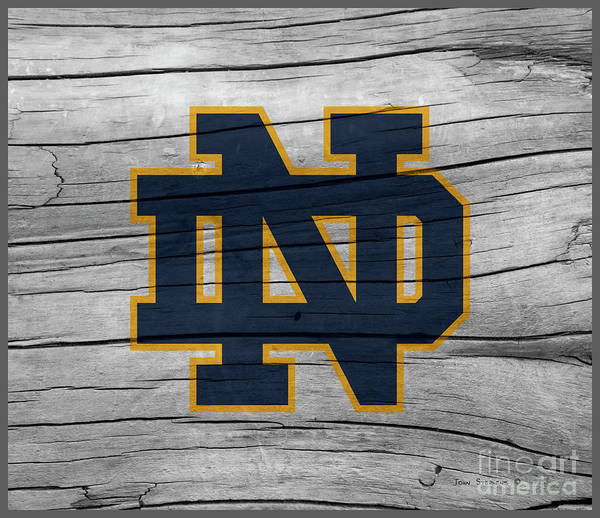 Wall Art - Photograph - University Of Notre Dame Fighting Irish Logo On Rustic Wood by John Stephens