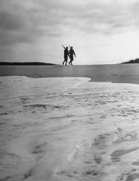 Rifle Photograph - Us Coast Guardsmen Walking On Beach Patr by William C. Shrout