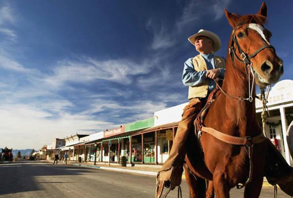 Tombstone Arizona Photograph - Usa, Arizona, Tombstone, Mature Cowboy by Walter Bibikow