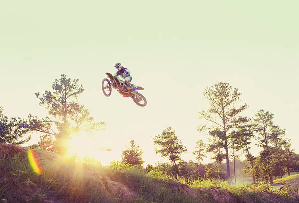Motorcycle Racing Photograph - Usa, Texas, Austin, Dirt Bike Jumping by Tetra Images - King Lawrence