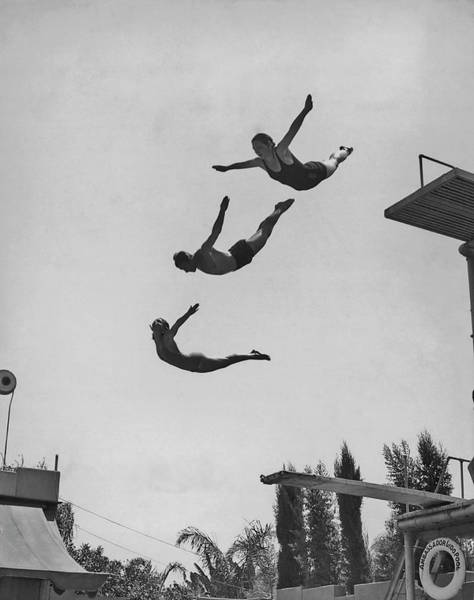 Shirtless Photograph - Using The Diving Board by Fpg