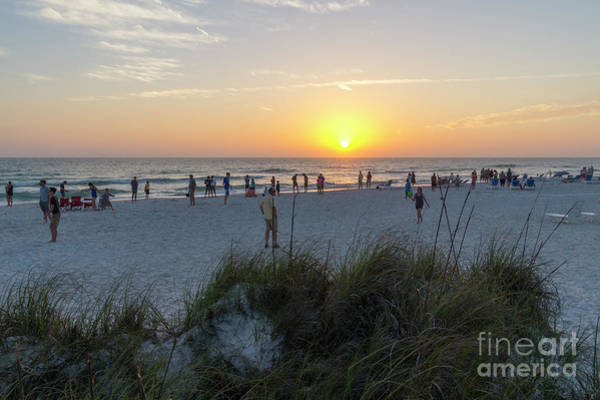Photograph - Vacationers Gather To Watch The Sunset Along The Beach On Anna M by William Kuta