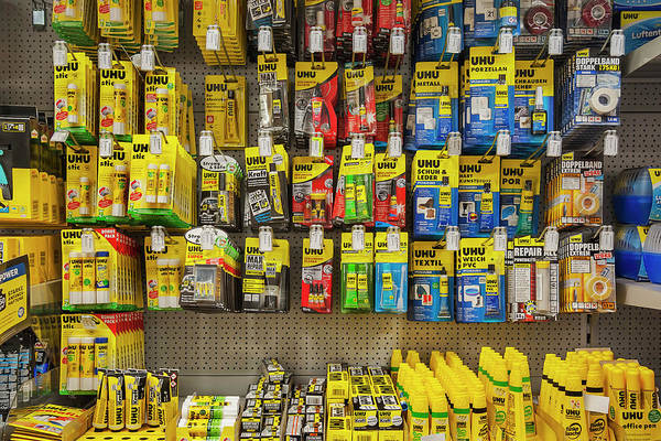 Wall Art - Photograph - Various Adhesives On Shelves Hardware Store Interior Bavaria Germany by imageBROKER - Manfred Bail