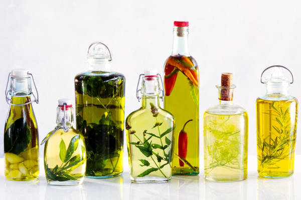 Salad Dressing Photograph - Various Bottles Of Flavoured Oils by Maximilian Stock Ltd.