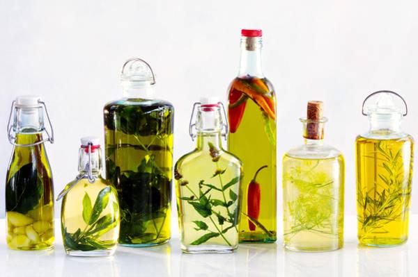 Walnut Photograph - Various Bottles Of Flavoured Oils by Maximilian Stock Ltd.