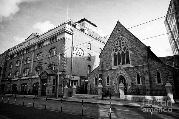 Wall Art - Photograph - Vhi Healthcare Building And Old Scots Presbyterian Church Ormond Quay And Scots Church Dublin Republ by Joe Fox